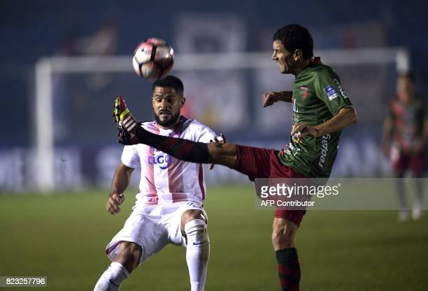 Paraguay's Cerro Porteno Juan Aguilar vies for the ball with Uruguay's Boston River Pablo Alvarez during their Sudamericana Cup football match at the...
