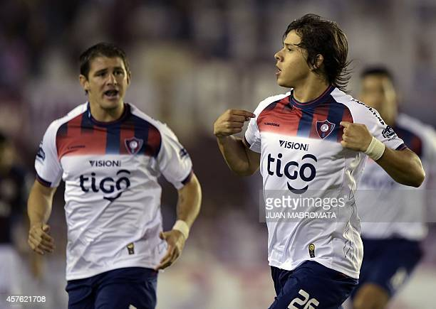 Paraguay's Cerro Porteno midfielder Oscar Romero celebrates next to teammate midfielder Mauricio Sperdutti after scoring a goal against Argentina's...