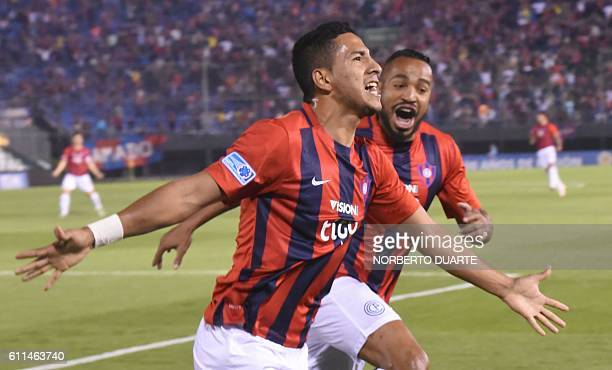 Paraguay's Cerro Porteno player Cecilio Dominguez celebrates after scoring against Colombia's Independiente Santa Fe during their Copa Sudamericana...