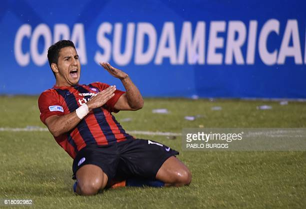 Paraguay's Cerro Porteno player Cecilio Dominguez celebrates after scoring against Colombia's Independiente de Medellin during their Copa...