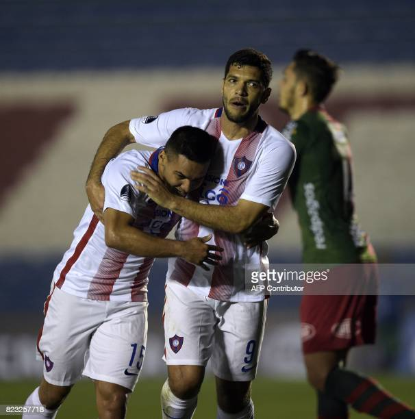 Paraguay's Cerro Porteno player Jorge Luis Rojas celebrates with teammate Jose Ortigoza after scoring a goal against Uruguay's Boston River during...