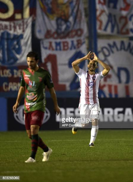 Paraguay's Cerro Porteno player Willian Candia celebrates after scoring the fourth goal against Uruguay's Boston River during their Sudamericana Cup...
