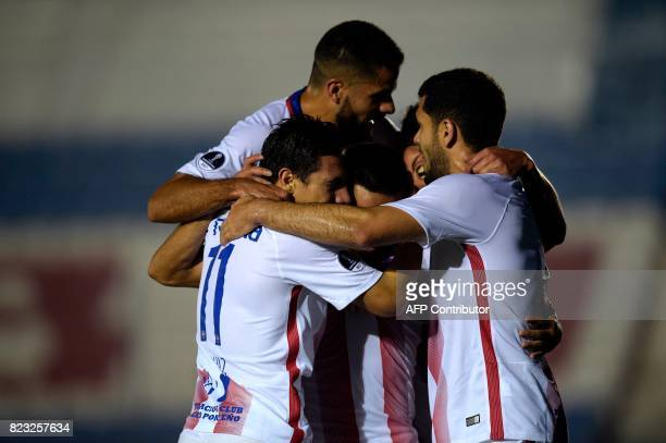 Paraguay's Cerro Porteno players celebrate after scoring a goal against Uruguay's Boston River during their Sudamericana Cup football match at the...
