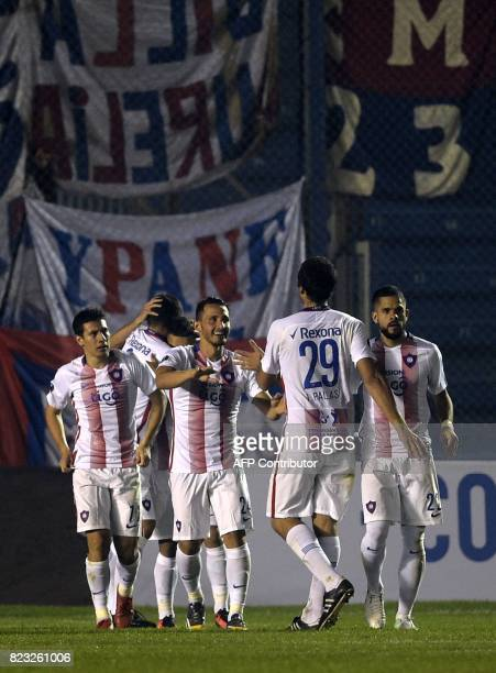Paraguay's Cerro Porteno players celebrate the second goal of the team against Uruguay's Boston River during their Sudamericana Cup football match at...
