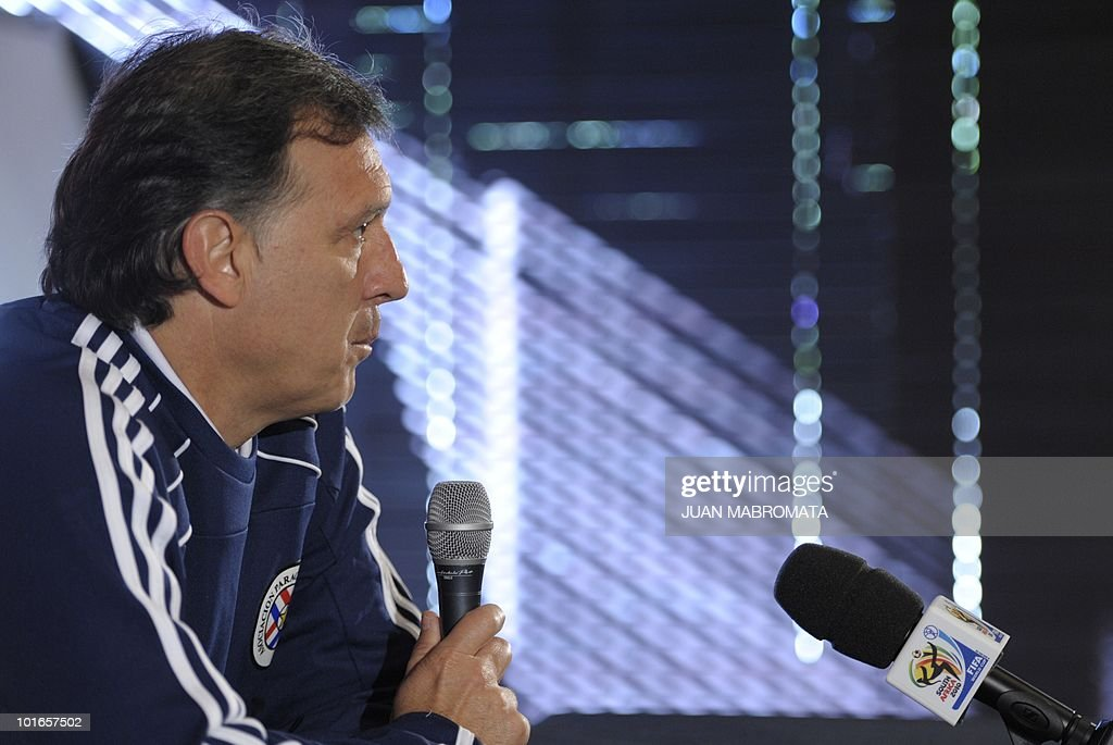 Paraguay's coach, Argentine Gerardo Martino, answers a question during a press conference at the base camp in Balgowan on June 6, 2010.Pararguay will face Italy in their opening match of the 2010 World Cup South Africa in Cape Town on June 14.