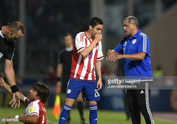 Paraguay's coach Francisco Arce speaks with Paraguay's Miguel Almiron during the Russia 2018 FIFA World Cup qualifier football match against...