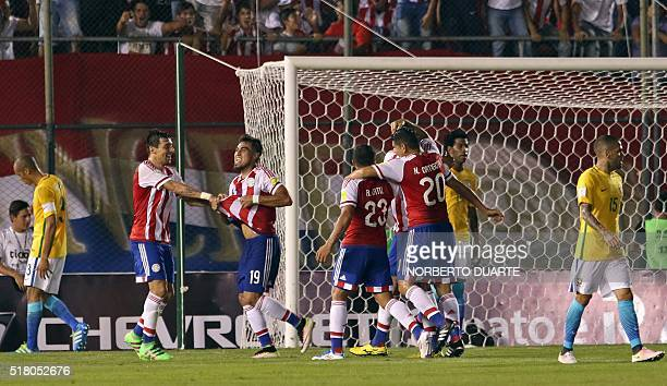 Paraguay's Dario Lezcano celebrates with teammates after scoring against Brazil during the Russia 2018 FIFA World Cup South American Qualifiers'...