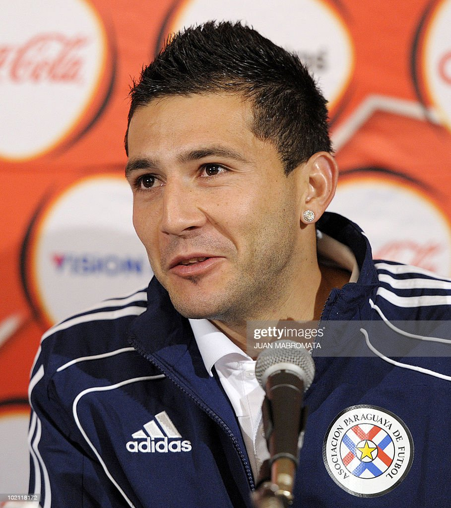 Paraguay's defender Antolin Alcaraz talks to journalist during a press conference at Michaelhouse School in Balgowan on June 15, 2010, a day after their 0-0 tie with Italy in the 2010 World Cup in South Africa.