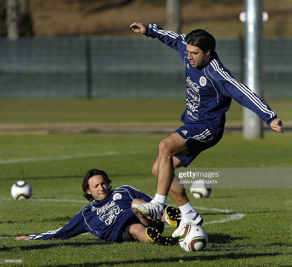 Paraguay's defender Julio Cesar Caceres (top) and midfielder Edgar Barreto vie for the ball during a training session at Michaelhouse school in Balgowan on June 5, 2010. Pararguay will face Italy in their opening match of the 2010 World Cup South Africa in Cape Town on June 14.