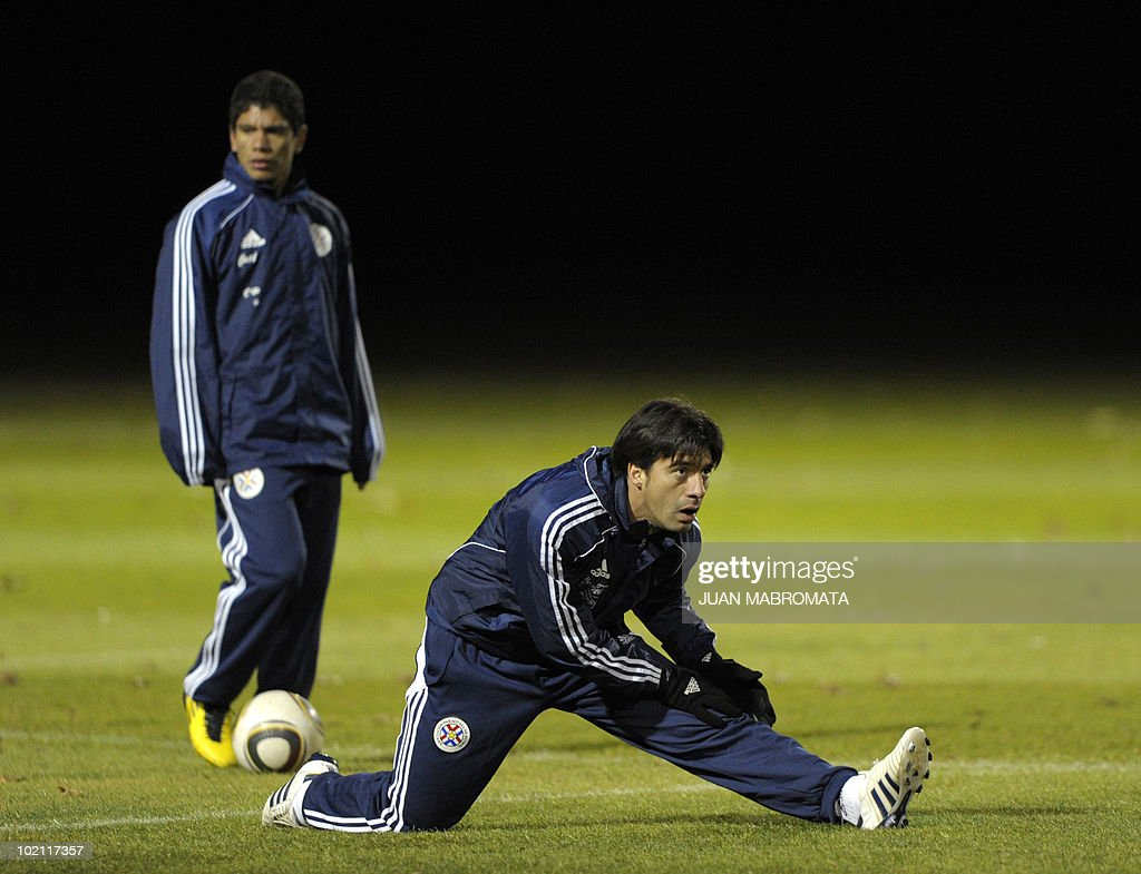 Paraguay's defender Julio Cesar Caceres (front R) stretches next to teammate forward Rodolfo Gamarra during a training session at Michaelhouse school in Balgowan on June 15, 2010 a day after their first match against Italy ended 1-1 and ahead their second 2010 World Cup Group F football match against Slovakia on June 20 at Free State stadium in Bloemfonstein.