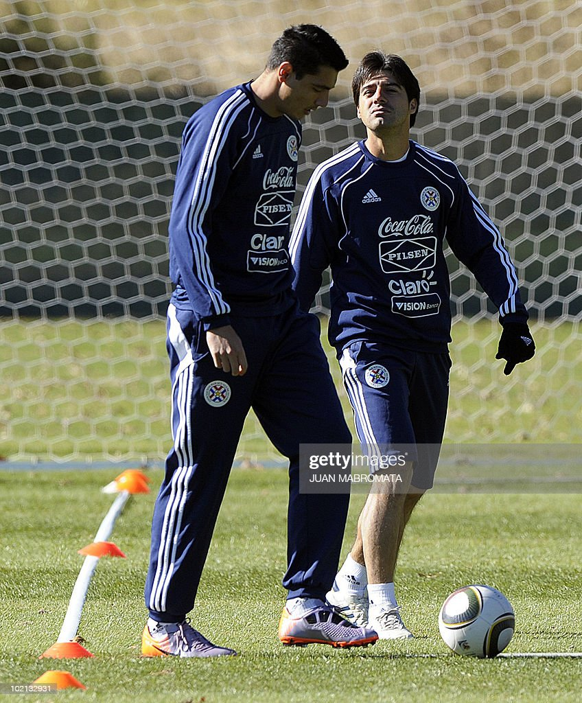 Paraguay's defender Julio Cesar Caceres (R) walks with striker Oscar Cardozo during a training session at Michaelhouse School in Balgowan on June 16, 2010 ahead their second 2010 World Cup Group F football match against Slovakia on June 20 at Free State Stadium in Bloemfonstein.