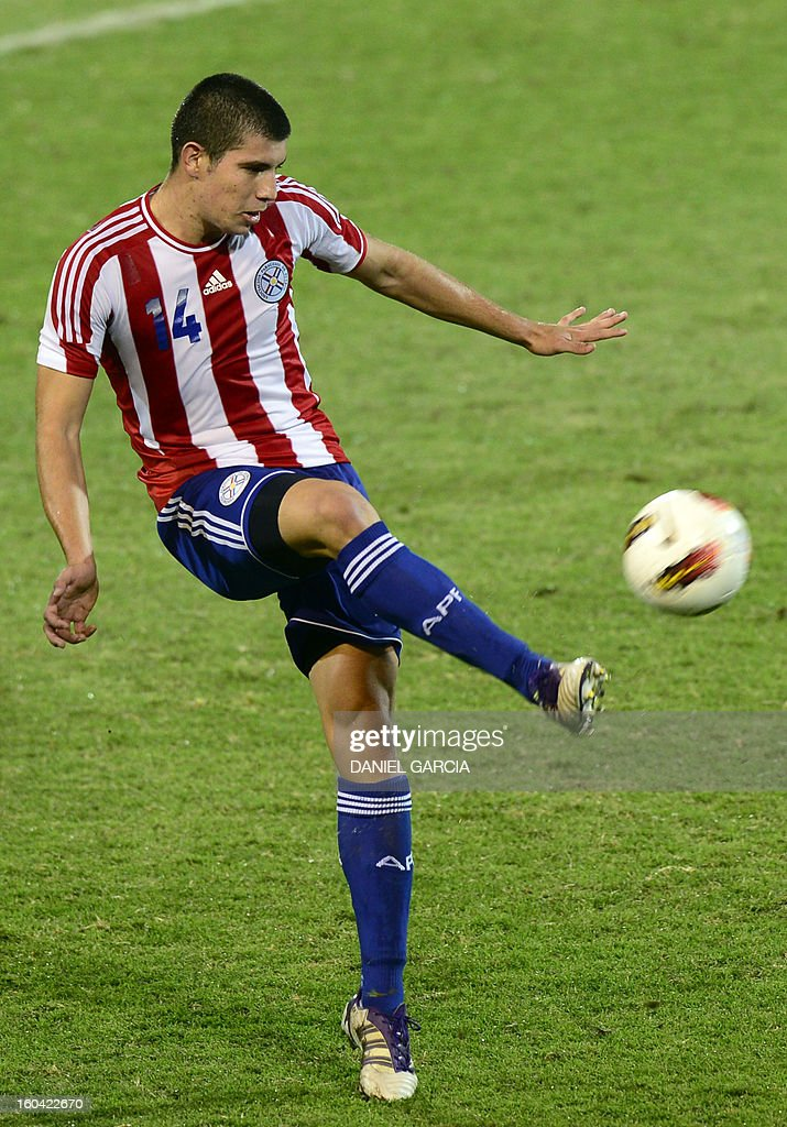Paraguay's defender Junior Alonso takes the ball with Uruguay's during their South American U-20 final round football match against Uruguay at Malvinas Argentinas stadium in Mendoza, Argentina, on January 30, 2013. Four teams will qualify for the FIFA U-20 World Cup Turkey 2013.