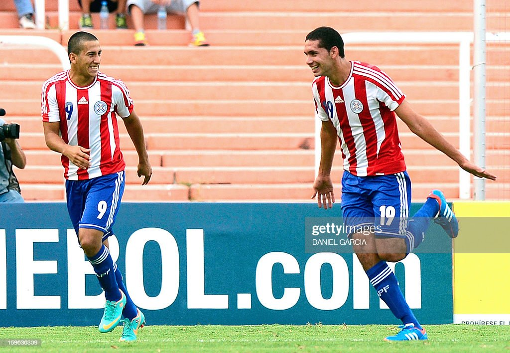 Paraguay's defender Matias Perez (R) celebrates with teammate forward Cecilio Dominguez after scoring against Bolivia during their South American U-20 Group A qualifier football match at Malvinas Argentinas stadium in Mendoza, Argentina, on January 17, 2013. Four teams will qualify for the FIFA U-20 World Cup Turkey 2013.