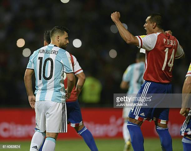 Paraguay's defender Paulo Da Silva celebrates after Argentina's Sergio Aguero misses a penalty kick during their Russia 2018 World Cup football...