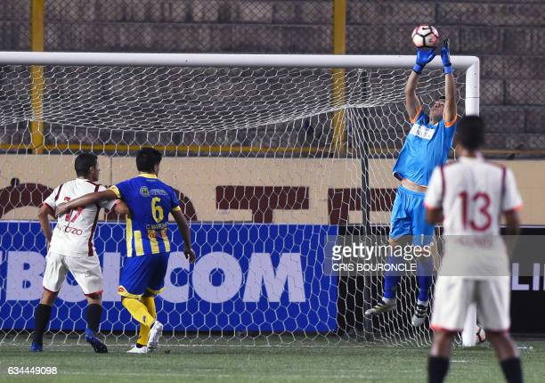 Paraguays Deportivo Capiata goalie Bernardo Medina jumps for the ball in the firstround Copa Libertadores football match against Perus Universitario...