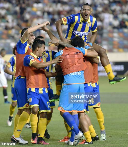 Paraguays Deportivo Capiata Jorge Rodriguez and teammates celebrate his goal against Peru's Universitario during their firstround Copa Libertadores...