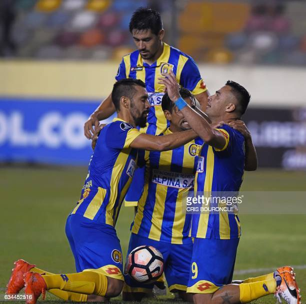 Paraguays Deportivo Capiata player Roberto Gamarra and teammates celebrate after he scores against Perus Universitario in their firstround Copa...