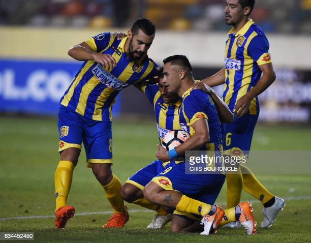 Paraguays Deportivo Capiata player Roberto Gamarra celebrates with teammates after scoring against Perus Universitario during their Copa Libertadores...