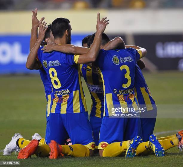 Paraguays Deportivo Capiata player Roberto Gamarra celebrates with teammates after scoring against Perus Universitario in their firstround Copa...