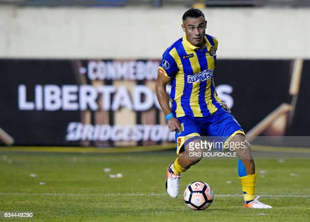 Paraguays Deportivo Capiata player Roberto Gamarra shoots to score against Perus Universitario in their firstround Copa Libertadores football match...