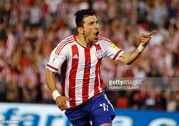 Paraguay's Edgar Benitez celebrates after scoring against Brazil during their Russia 2018 FIFA World Cup South American Qualifiers' football match in...