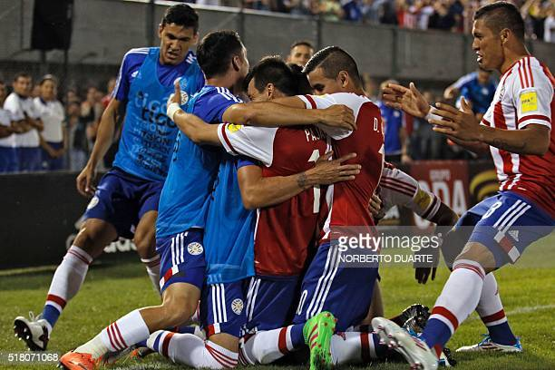 Paraguay's Edgar Benitez celebrates with teammates after scoring against Brazil during their Russia 2018 FIFA World Cup South American Qualifiers'...