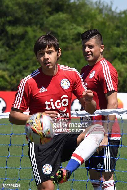 Paraguay's footballers Oscar Romero and Jorge Moreira take part in a training session at the Albiroga Complex training centre in Ypane near Asuncion...