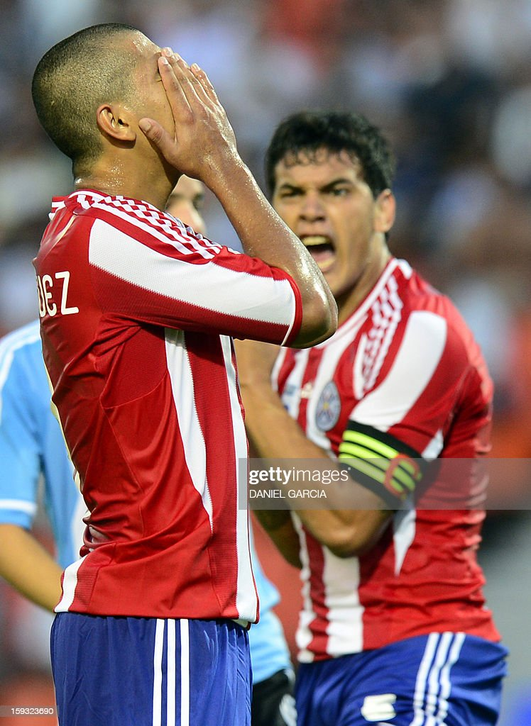 Paraguay's forward Cecilio Dominguez (L) reacts after missing an opportunity to score against Argentina, while team captain Gustavo Gomez shouts at him, during their South American U-20 Championship Group A football match, at Malvinas Argentinas stadium in Mendoza, Argentina, on January 11, 2013. Four South American teams will qualify for the FIFA U-20 World Cup Turkey 2013.