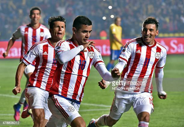 Paraguay's forward Derlis Gonzalez celebrates after scoring a penalty against Brazil during their 2015 Copa America football championship...