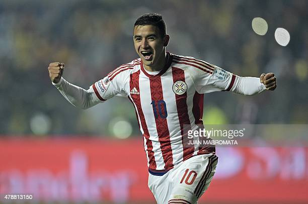 Paraguay's forward Derlis Gonzalez celebrates after scoring the last penalty kick during their 2015 Copa America football championship quarterfinal...