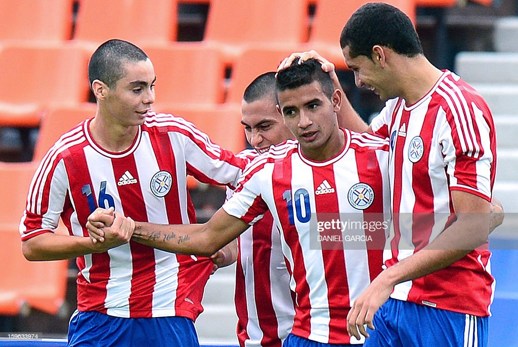 Paraguay's forward Derlis Gonzalez (2-R) celebrates with teammates midfielder Miguel Almiron and defender Matias Perez (R) after scoring against Bolivia during their South American U-20 Group A qualifier football match at Malvinas Argentinas stadium in Mendoza, Argentina, on January 17, 2013. Four teams will qualify for the FIFA U-20 World Cup Turkey 2013.