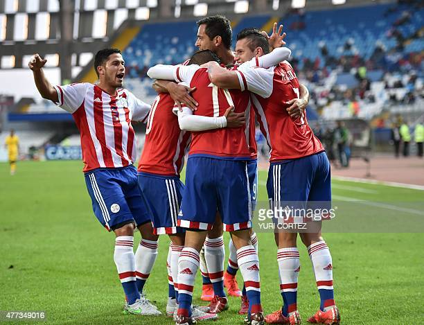 Paraguay's forward Edgar Benitez celebrates with teammates after scoring against Jamaica during their 2015 Copa America football championship match...