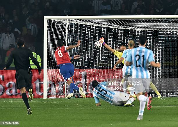 Paraguay's forward Lucas Barrios celebrates scores against Argentina during their Copa America semifinal football match in Concepcion Chile on June...