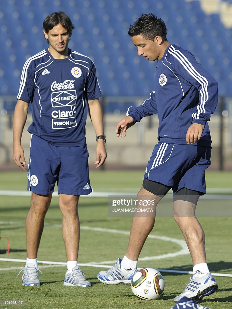 Paraguay's forward Lucas Barrios (R) controls the ball next to teammate Roque Santa Cruz during a training session at Harry Gwala stadium in Pietermaritzburg on June 6, 2010 ahead of the 2010 World Cup in South Africa.