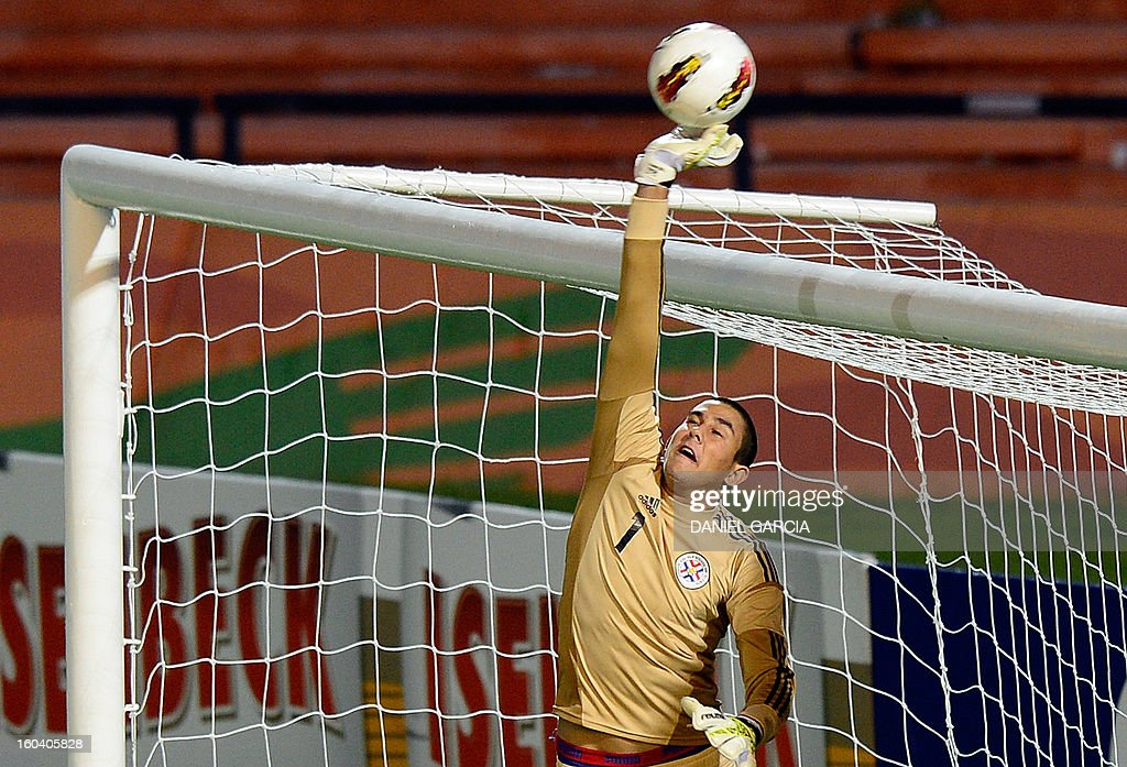 Paraguay's goalkeeper Diego Morel deflects the ball over the crossbar during the South American U-20 final round football match against Uruguay at Malvinas Argentinas stadium in Mendoza, Argentina, on January 30, 2013. Four teams will qualify for the FIFA U-20 World Cup Turkey 2013.