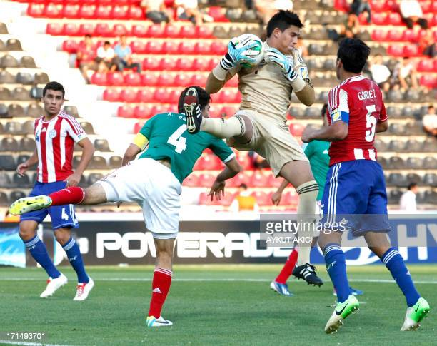 Paraguay's goalkeeper Diego Morel jumps for the ball during the group stage football match between Mexico v Paraguay at the FIFA Under 20 World Cup...