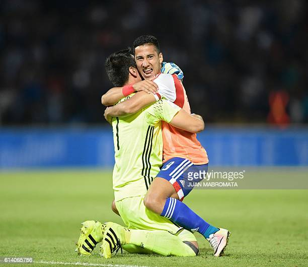 Paraguay's goalkeeper Justo Villar celebrates with Paraguay's Cecilio Dominguez the 01 team victory against Argentina at the end of their Russia 2018...