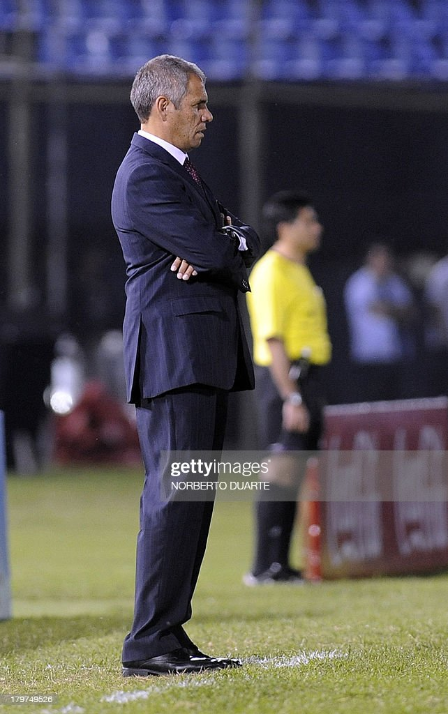 Paraguay's head coach Victor Genes watches the pitch during their FIFA World Cup Brazil 2014 South American qualifying football match against Bolivia at Defensores del Chaco stadium in Asuncion on September 6, 2013.
