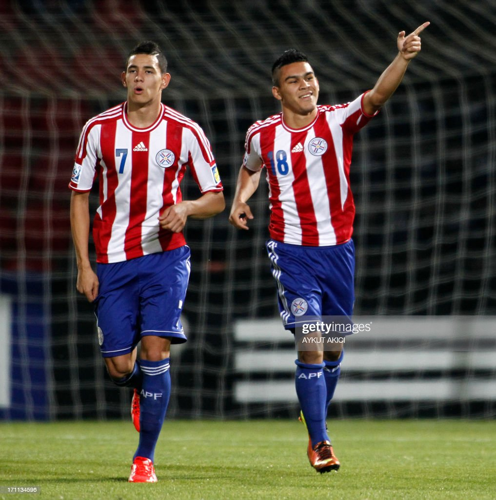 Paraguay's Jorge Rojas (R) celebrates after scoring a goal during the group stage football match between Mali and Paraguay at the FIFA Under 20 World Cup at the Kamil Ocak stadium in Gaziantep on June 22, 2013. AFP PHOTO/TURKPIX/Aykut AKICI