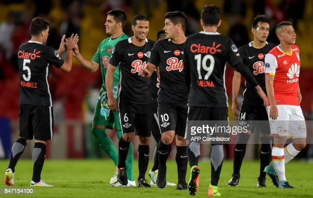 Paraguay's Libertad and Colombia's Santa Fe players greet each other at the end of the Copa Sudamericana football match at El Campin stadium in...