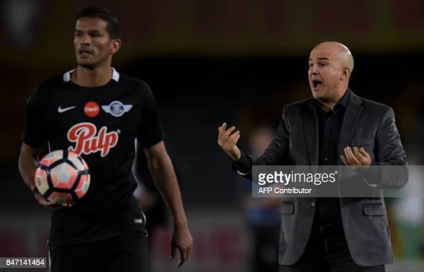 Paraguay's Libertad coach Fernando Jubero gestures during their Copa Sudamericana football match againts Colombia's Santa Fe at El Campin stadium in...