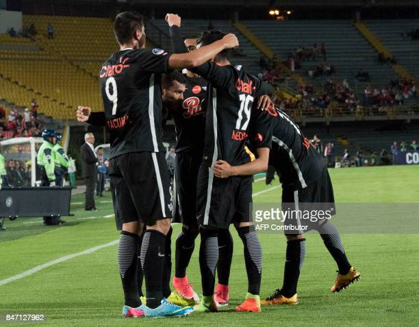 Paraguay's Libertad footballers celebrate after scoring against Colombia's Santa Fe during their Copa Sudamericana football match at El Campin...