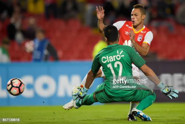 Paraguay's Libertad goalkeeper Carlos Servin stops Colombia's Santa Fe Anderson Plata shot during their Copa Sudamericana football match at El Campin...