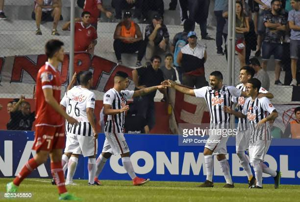 Paraguay's Libertad Jorge Recalde celebrates with teammates after scoring against Argentina's Huracan during their Copa Sudamericana 2017 second...