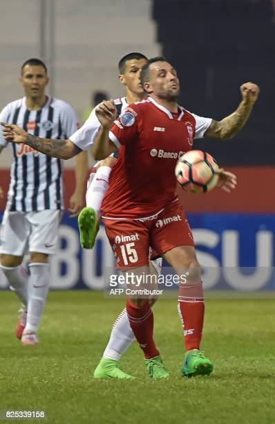 Paraguay's Libertad player Alan Benitez vies for the ball with Argentina's Huracan Mariano Gonzalez during their Copa Sudamericana 2017 second stage...
