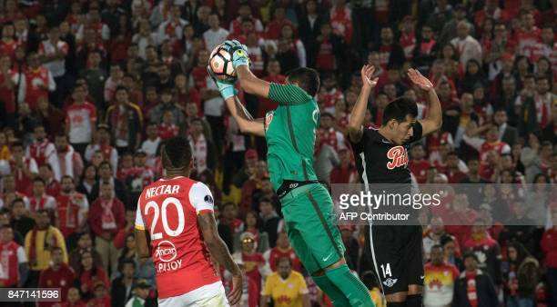 Paraguay's Libertad player Carlos Servín Caballero vies for the ball with Colombia's Santa Fe player John Pajoy during their 2017 Copa Sudamericana...