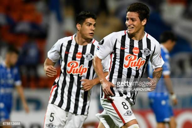 Paraguay´s Libertad player Danilo Santacruz celebrates after scoring his first goal against Argentina's Godoy Cruz during their Copa Libertadores...