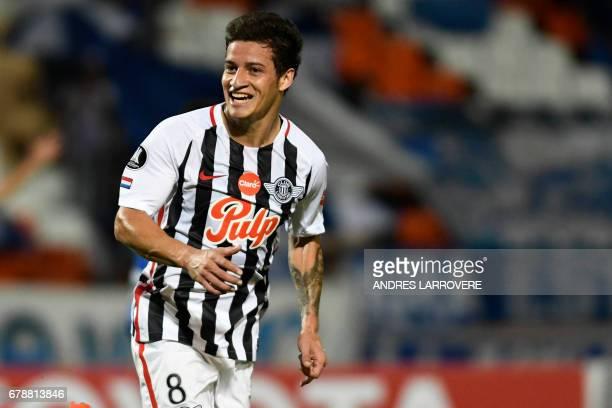 Paraguay's Libertad player Danilo Santacruz celebrates after scoring his first goal against Argentina's Godoy Cruz during their Copa Libertadores...