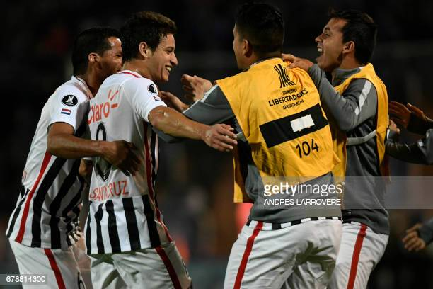 Paraguay´s Libertad player Danilo Santacruz celebrates with teammates after scoring his first goal against Argentina's Godoy Cruz during their Copa...