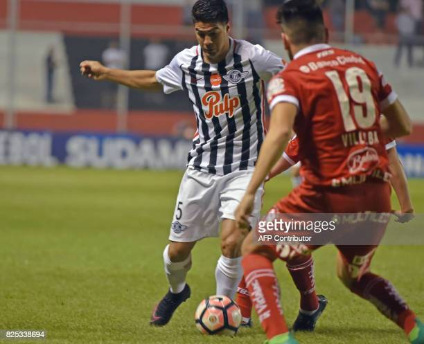 Paraguay's Libertad player Ivan Ramirez vies for the ball with Argentina's Huracan Lucas Villalba during their Copa Sudamericana 2017 second stage...